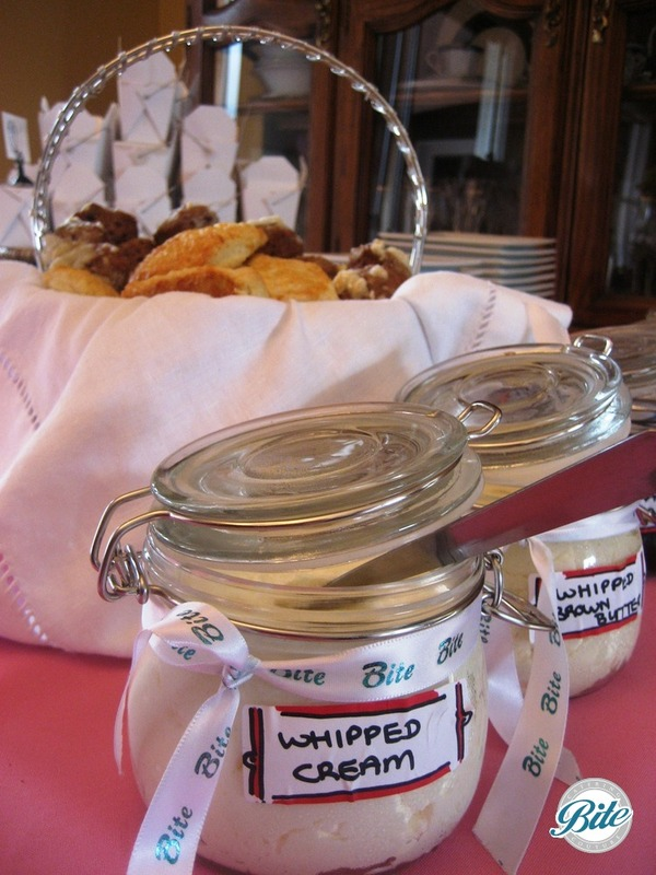 House made whipped cream in vintage jars with fresh scones
