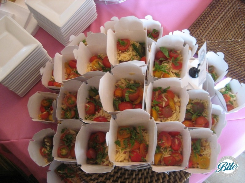 Orzo salad with mint and heirloom tomato, stacked on stationary display