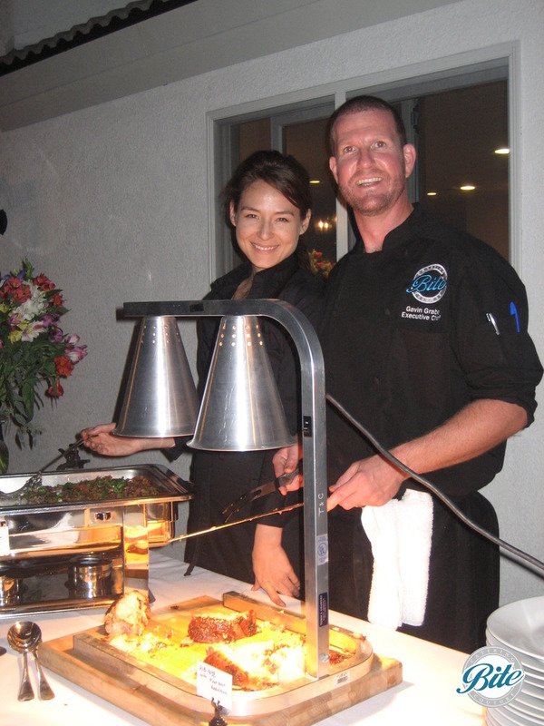 Bite Chef and Server at meat carving station serving guests