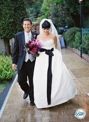 Couple exiting outdoor ceremony with smiles