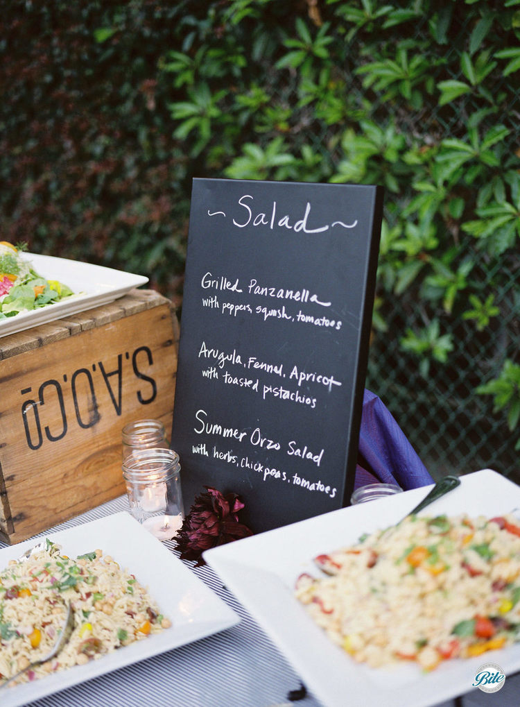 Grilled panzanella, arugla, and summer orzo market salad display for outdoro wedding reception