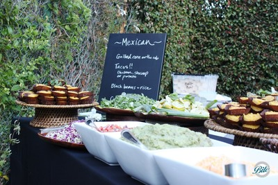 Taco bar station with all the fixings, including corn cake, guacamole, pico de gallo