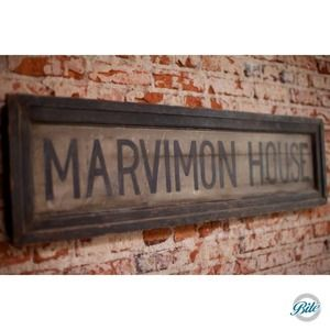 Wooden sign for the Marvimon House