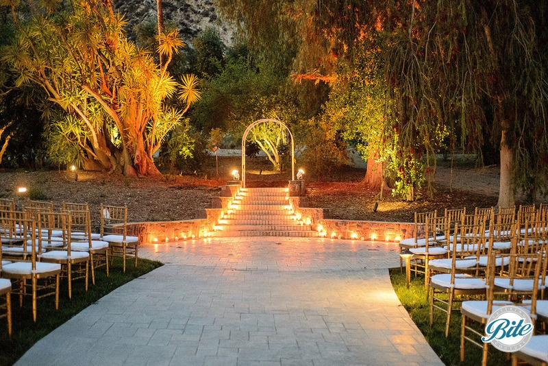 Wedding altar at Newhall Mansion in the backyard.  Lit entryway.