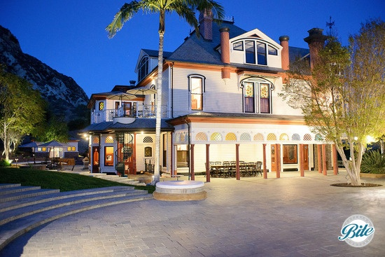 Beautifully lit facade of Newhall Mansion at night