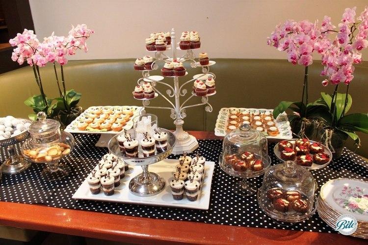 Dessert display for baby shower with dessert shots, key lime pie bites, red velvet cupcakes