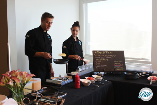 In - office brunch with omelette action station, Bite chefs freshly preparing orders for guests