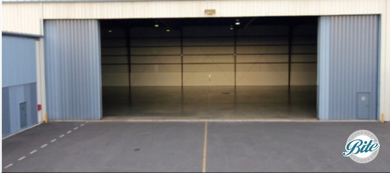 Undecorated entrance to Hangar 8 warehouse