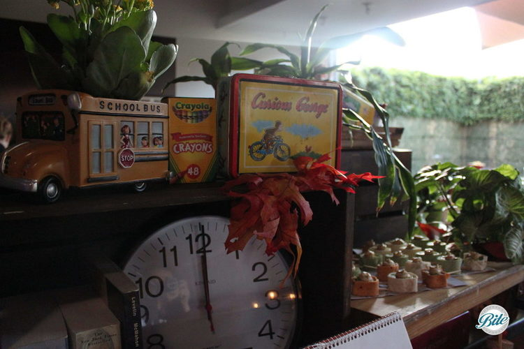 School room themed catering display with school bus vase, fall leaves, lunch box and crayon details