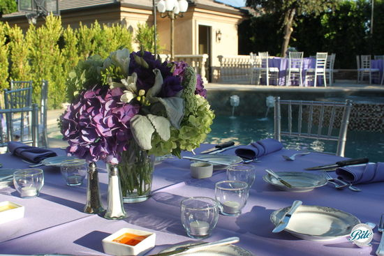 Outdoor dinner party table set up with purple, lavender and green colors