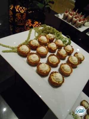 on stationary dessert buffet with fresh flowers and candles for presentation
