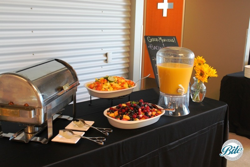 'Good morning' breakfast station with Orange Juice, Sausage, Scrambled Eggs, Berries, and Fruit