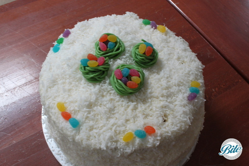 Easter basket cake with next baskets and easter eggs