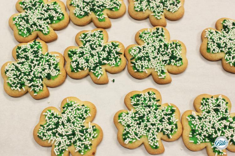 Sugar cookies for St Patricks shaped like shamrocks.