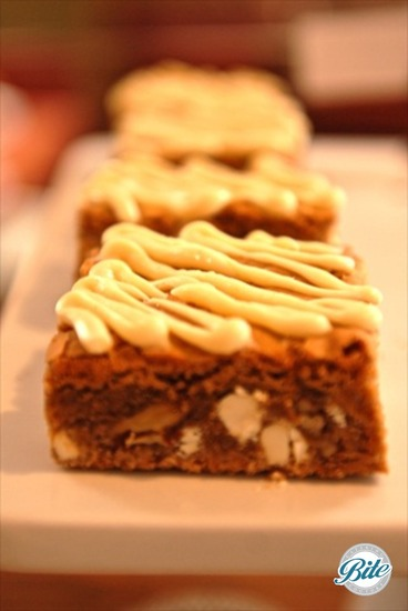 Blondie Bites on tray with ribbon frosting