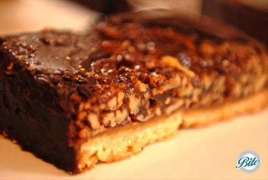 Buttery Shortbread Topped with Gooey Pecan Topping and Chocolate Ganache