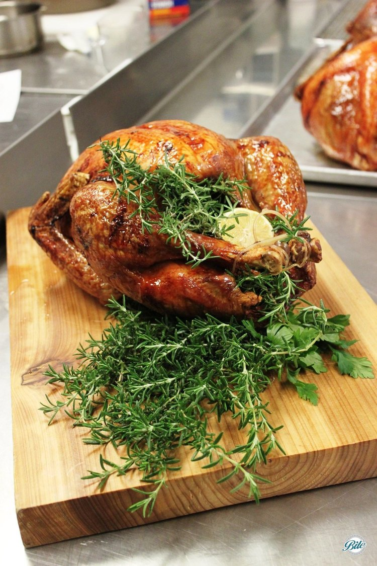 Turkey on carving board ready for your Thanksgiving feast! Filled with herbs: rosemary, lemon
