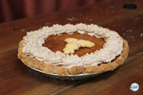Fall pumpkin pie with cinnamon whipped cream and leaf topper