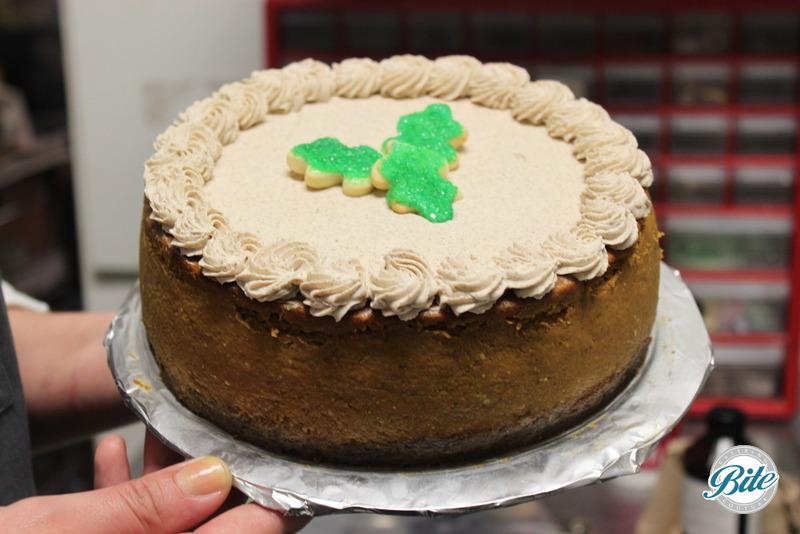 Seasonal fall pumpkin cheesecake with gingersnap crust and leaf topper