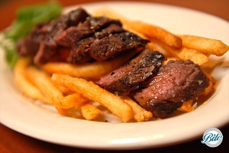 New York Strip, pommes frites with herb seasoning