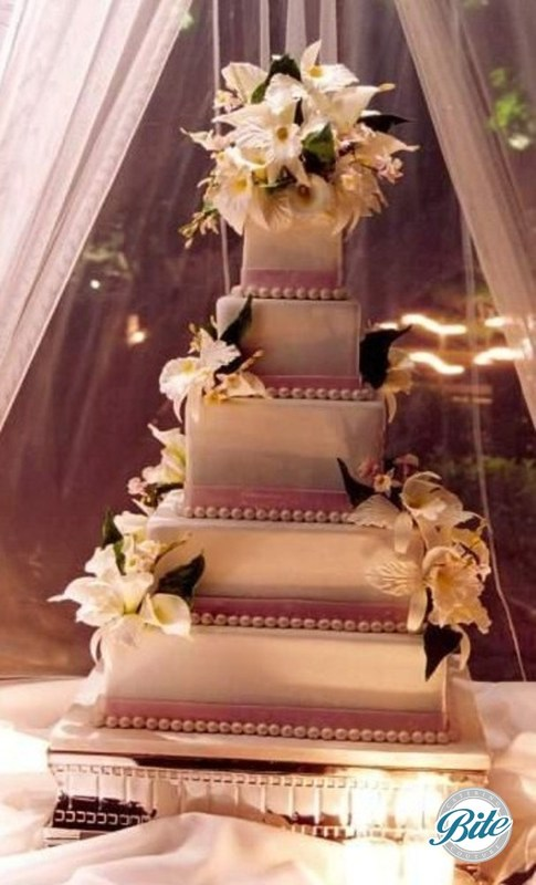 5 tier wedding cake with sugar flowers and lavender ribbon