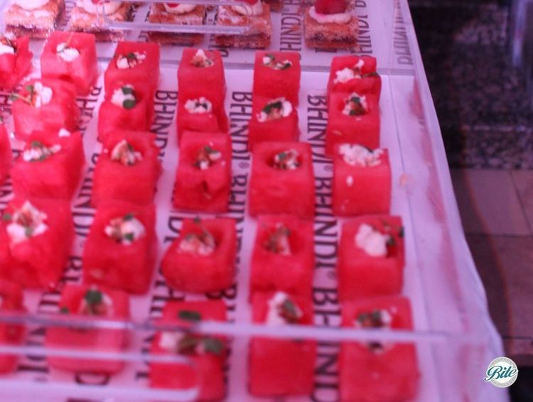 Watermelon cubes on branded trays