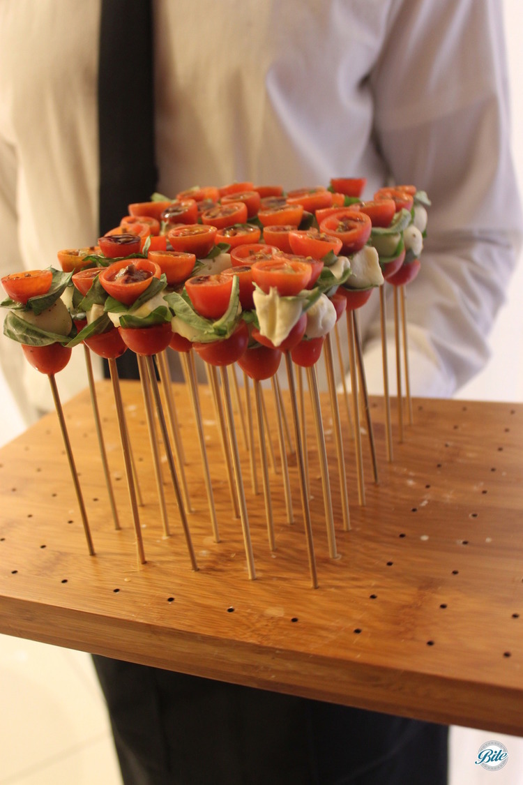 Cherry tomato, balsamic reduction, basil and fresh mozzarella, served vertically for added interest