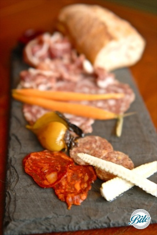 Charcuterie on a slate plate - tapas style with artisan bread