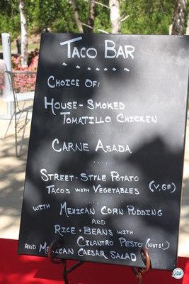 Taco bar menu on chalkboard sign