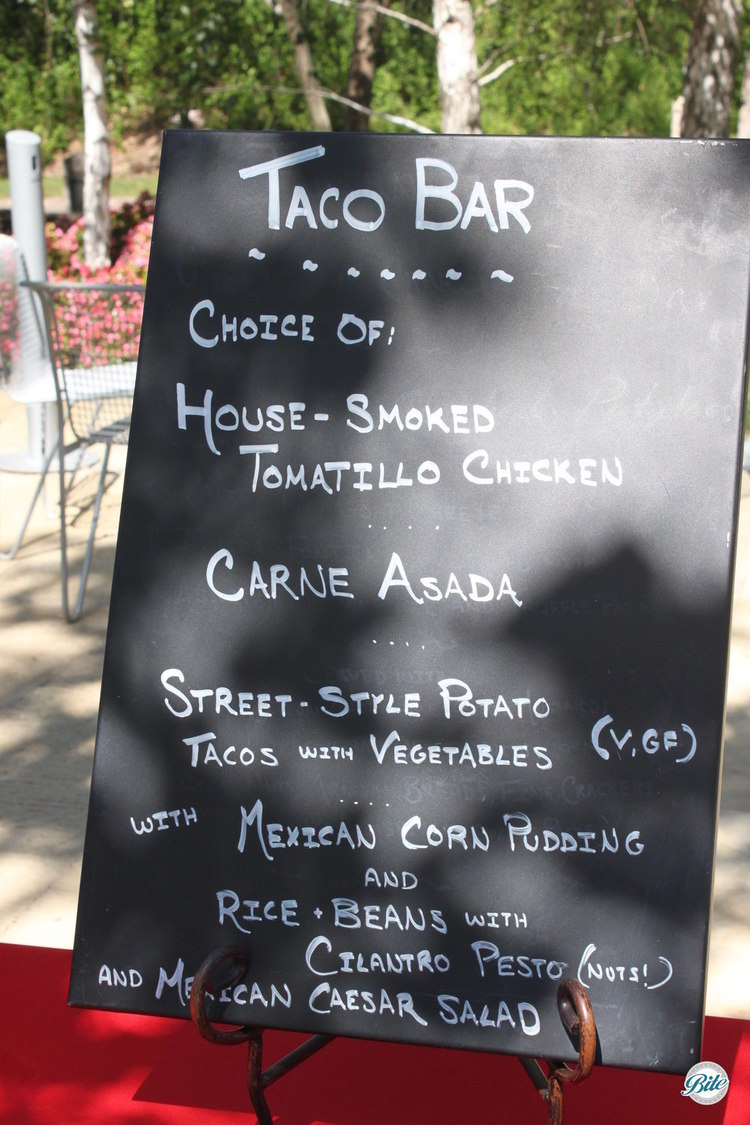 Taco bar menu on chalkboard sign