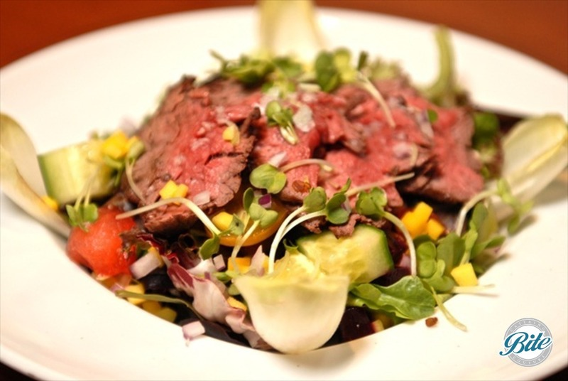 Market salad with grilled hangar steak, endive, micro greens, mesculn, tomatoes, cucumbers and dijon vinaigrette