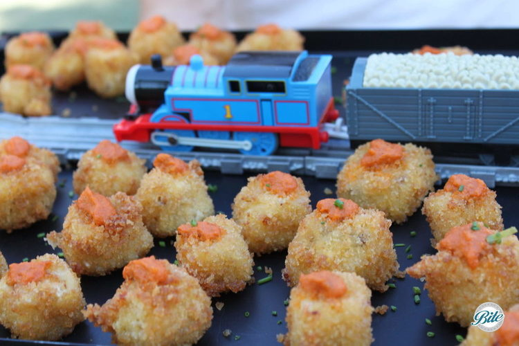 Crispy mac n cheese bites at film premiere with Thomas the Train piece running through the display