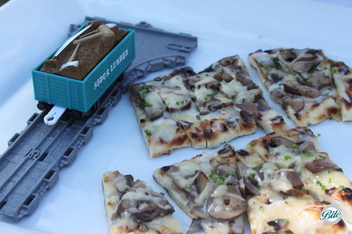 Mushroom and cheese pizza on train themed display