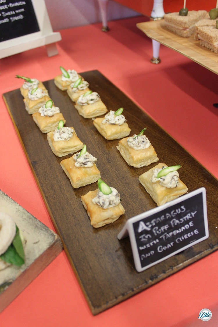 Vegetarian bite: asparagus puff pastry on stationary display