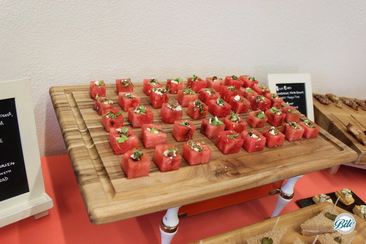 watermelon cubes displayed on wooden cutting board