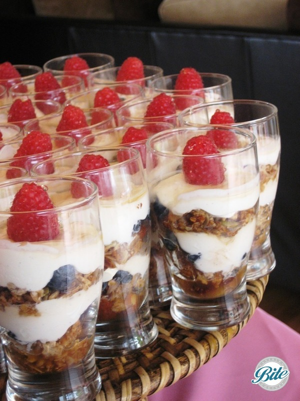 Granola parfait in individual cups, topped with raspberry