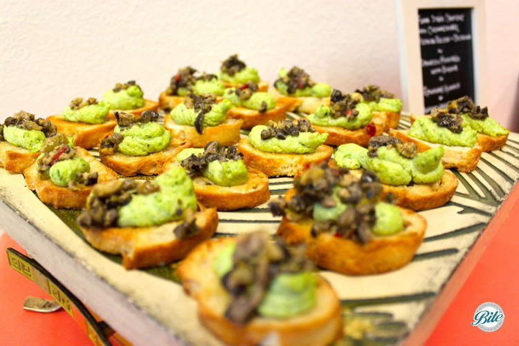 Up close shot of the edamame hummus crostini with olive tapenade
