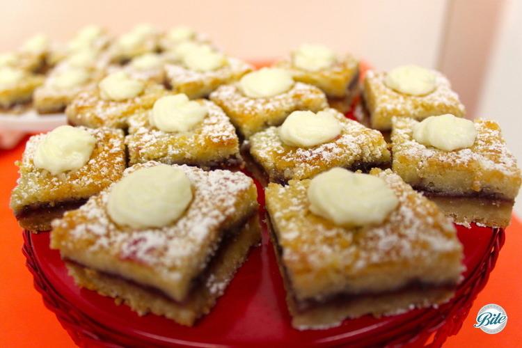 Yummy raspberry shortbread bite with powdered sugar