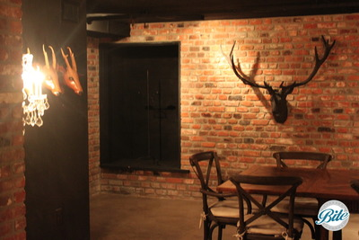 Underground tavern at Newhall Mansion. Wooden tables and lodge style decor lend a classic ambiance.