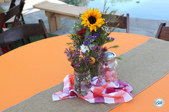 Rustic/ picnic themed centerpiece in mason jar with sunflower and willdflowers
