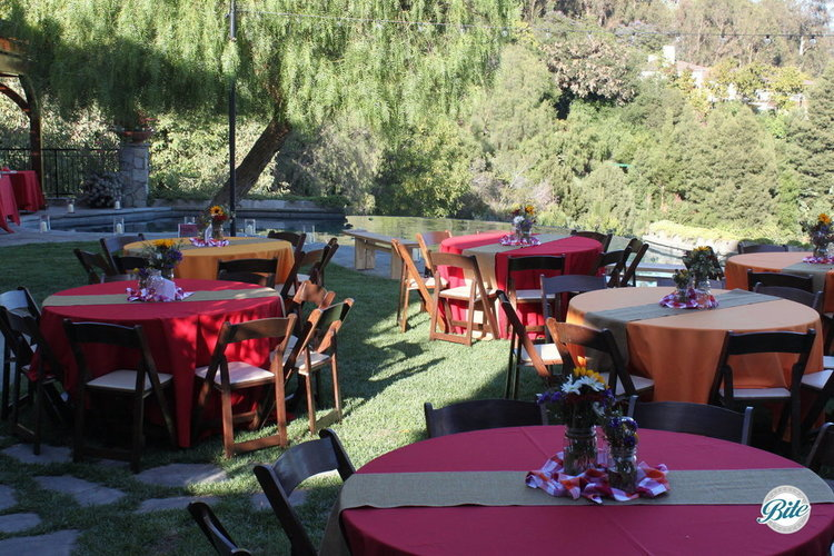 Tables laid out in the backyard for a wonderful summer event