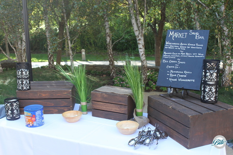 Setup for market salad bar using rustic wooden risers