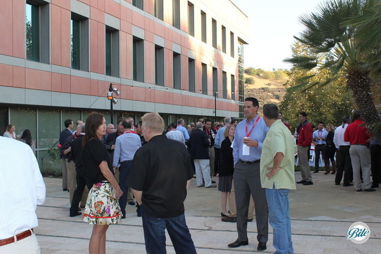 Guests gather for cocktail hour outside the office building