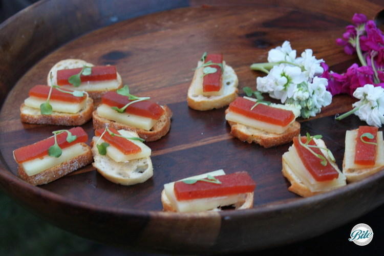Manchego cheese crostini with micro-green garnish