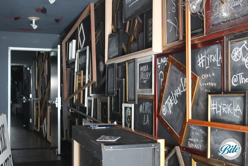 Entrance to Lyric Theater at Voila Gallery is covered by chalkboards and frames.