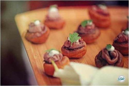 Tray passed Yorkshire Pudding Bites with creme fraiche and herb garnish served tray passed