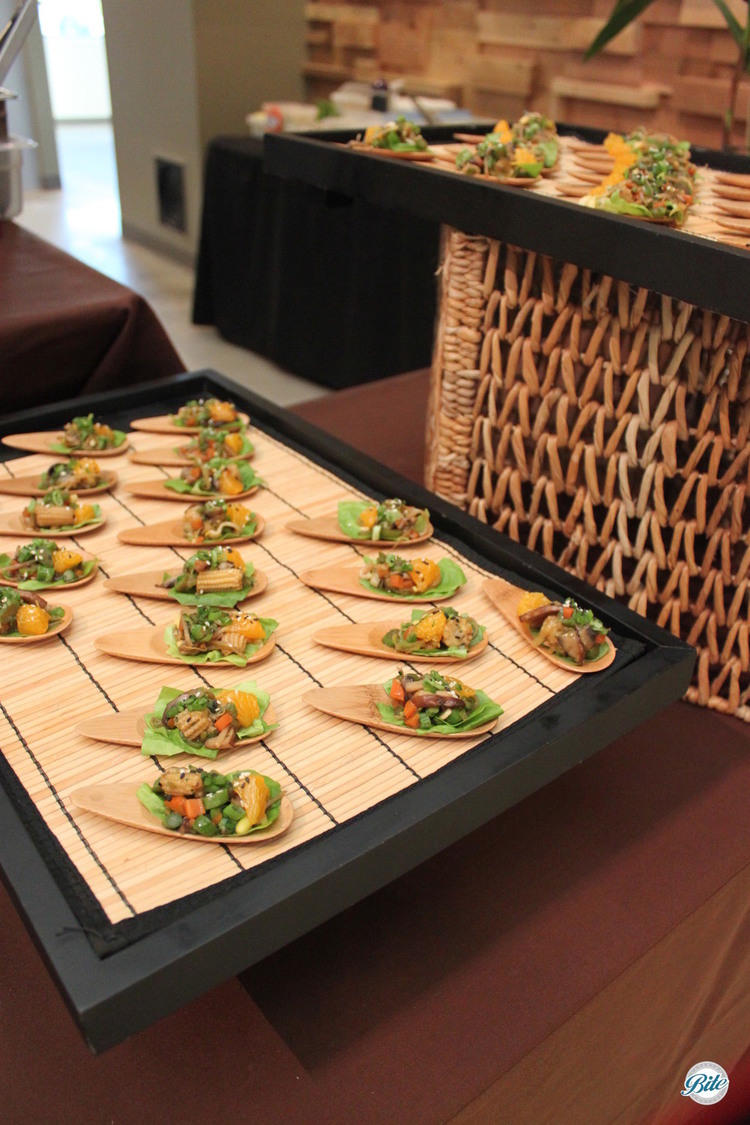 Lettuce Wrap Bites on Bamboo Spoons on Asian display
