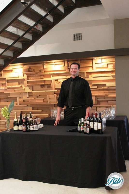 Wine and beer bar set up for in - office corporate catering
