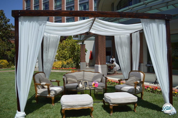 Bridal shower lounge set up with cabana and furniture for guests to enjoy