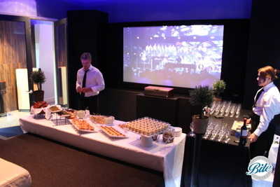 Corporate private film screening with stationary food display and bar, with Bite staff ready to greet guests